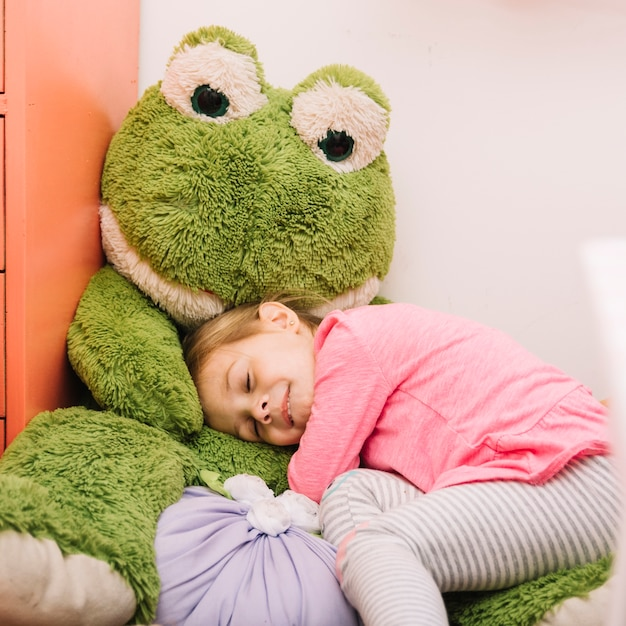Cute girl sleeping with soft toy Free Photo