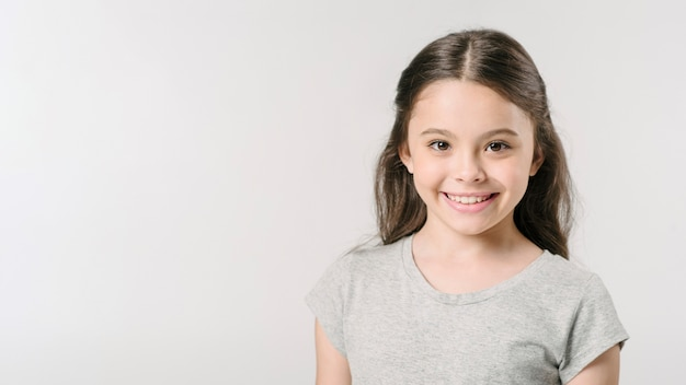 Cute girl smiling in studio Free Photo