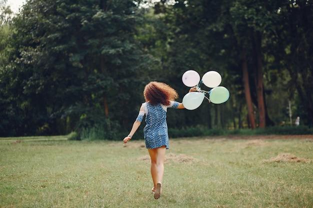 Cute girl walking in a summer park Free Photo