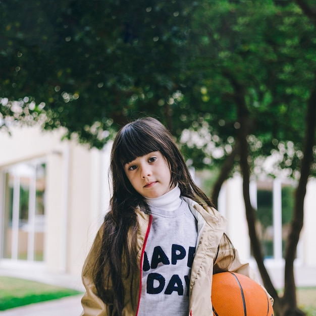 Cute girl with basketball ball Photo | Free Download