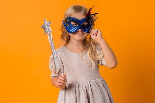 Cute girl with mask in costume Free Photo