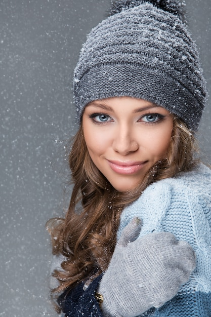 Cute girl with snowflakes having a good time Free Photo