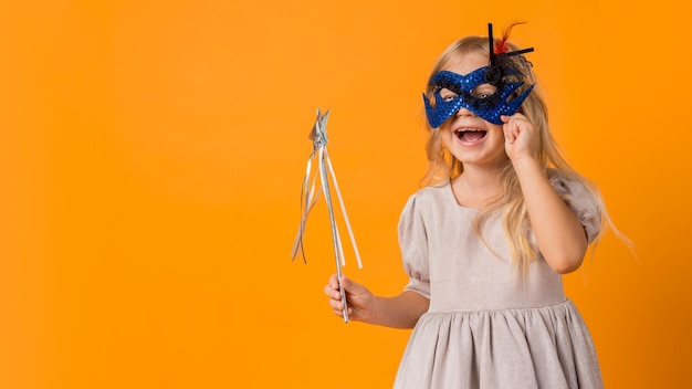 Cute girl with wand in costume Free Photo