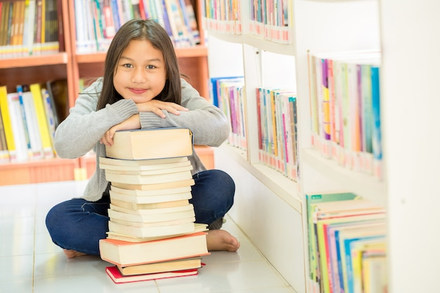 Cute girls and many books Free Photo