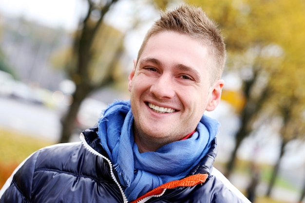 Cute guy having a walk in cold autumn day Free Photo