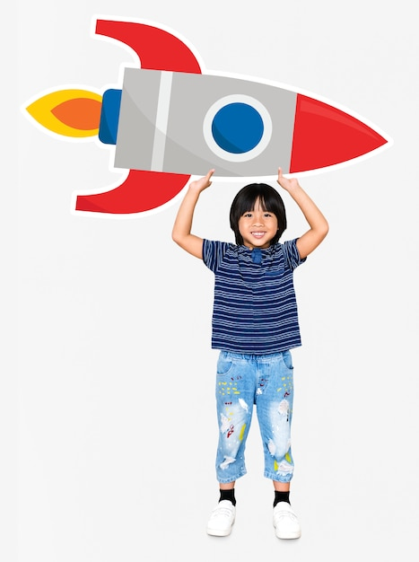 Cute happy boy holding a rocket icon Premium Photo