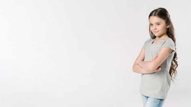 Cute junior standing in studio Free Photo