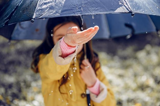 Cute kid plaiyng on a rainy day Free Photo