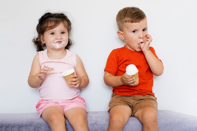 Cute kids eating ice cream Free Photo