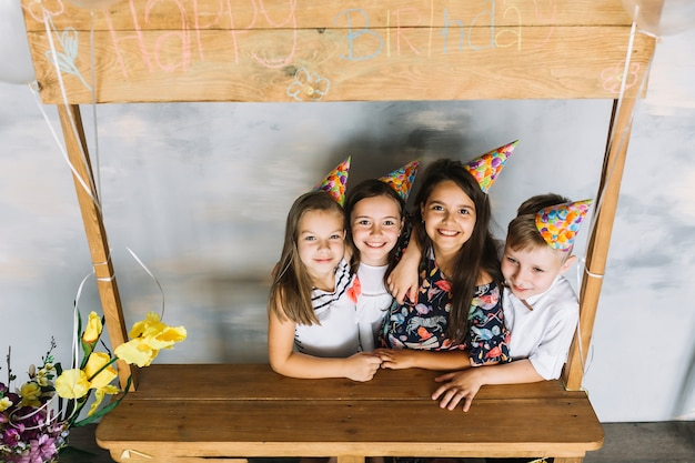 Cute kids embracing on birthday party Free Photo