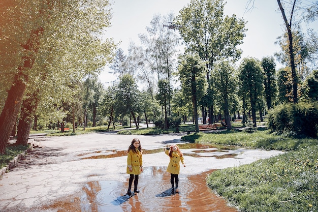 Cute kids plaiyng on a rainy day Free Photo