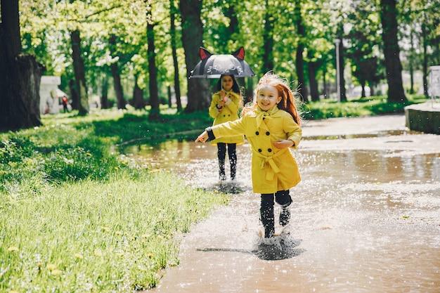 Cute kids plaiyng on a rainy day Free Photo