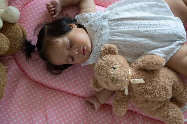 Cute little asian baby girl sleeping Premium Photo