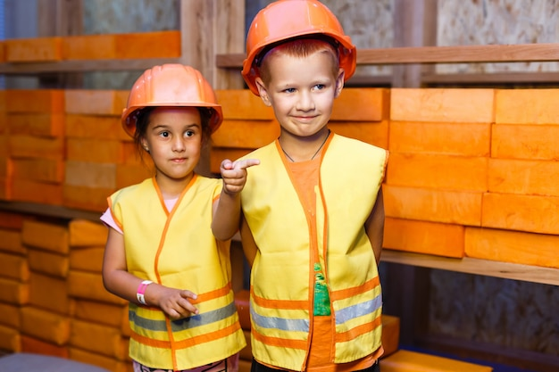 Cute little boy and girl playing with toy tools and smiling at camera Premium Photo