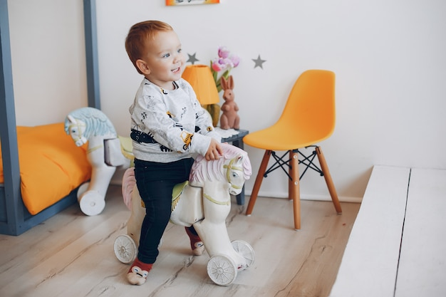 Cute little boy playing at home Free Photo