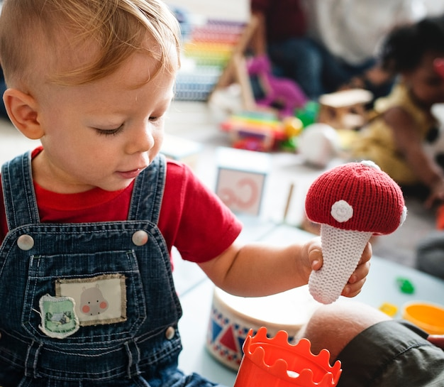 Cute little boy playing with toys at the learning center Premium Photo