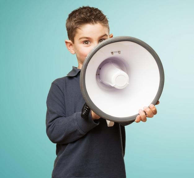 Cute little boy using a megaphone Free Photo