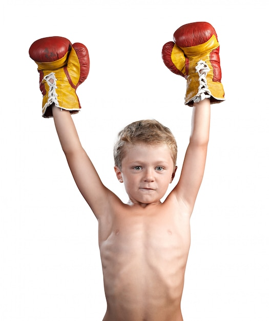 Cute little boy with boxing gloves isolated Premium Photo