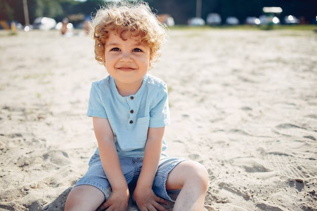 Cute little children playing on a sand Free Photo