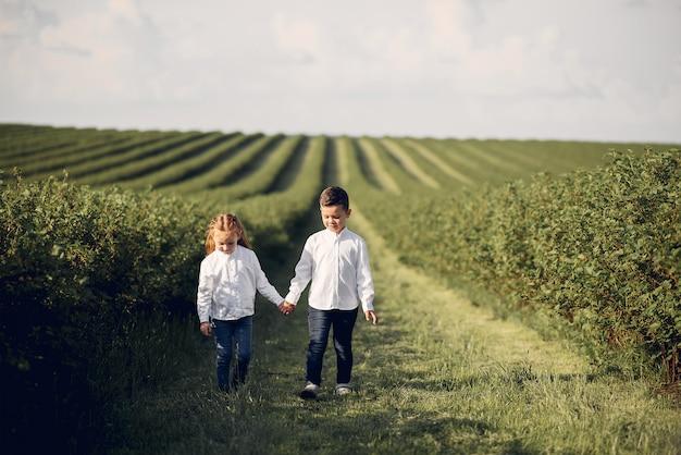 Cute little children in a spring field Free Photo