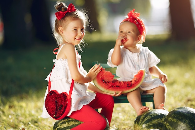 Cute little children with watermelons in a park Free Photo