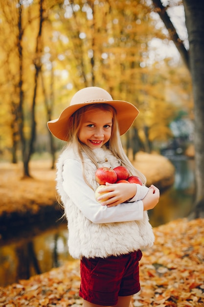 Cute little girl in a autumn park Free Photo