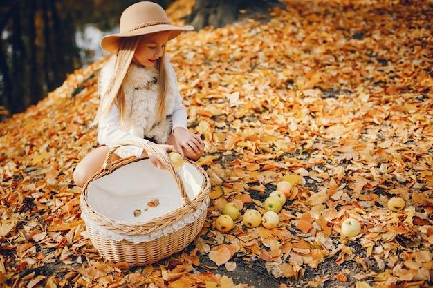 Cute little girl in a autumn park Free Photo