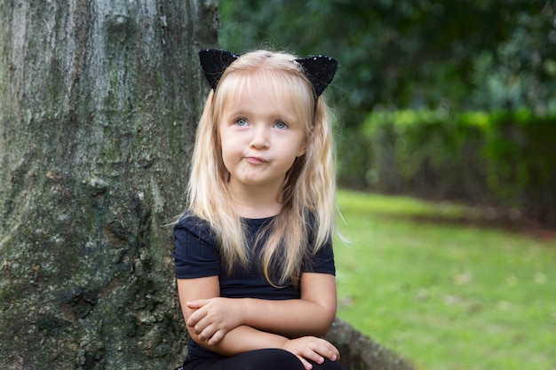 Cute little girl in costume of black cat for halloween Premium Photo