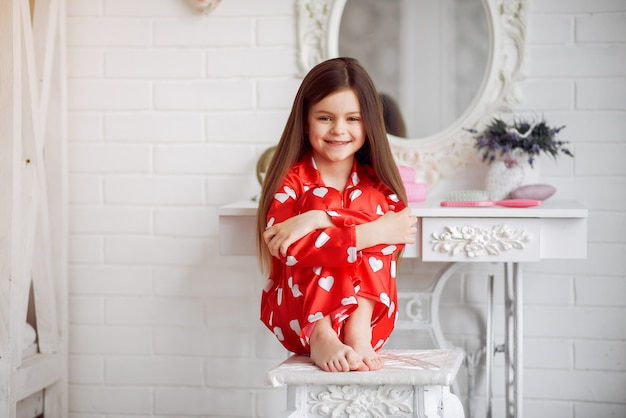 Cute little girl at home in a pajamas Free Photo