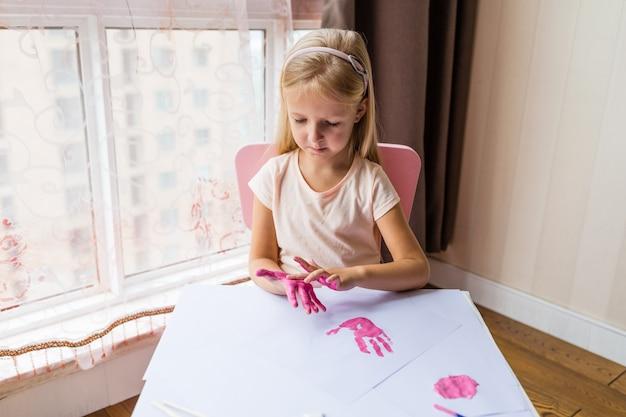 Cute little girl learn make handrint Premium Photo