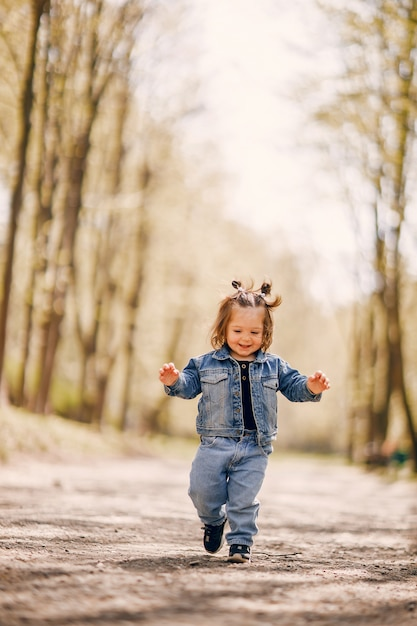 Cute little girl in a spring park Free Photo