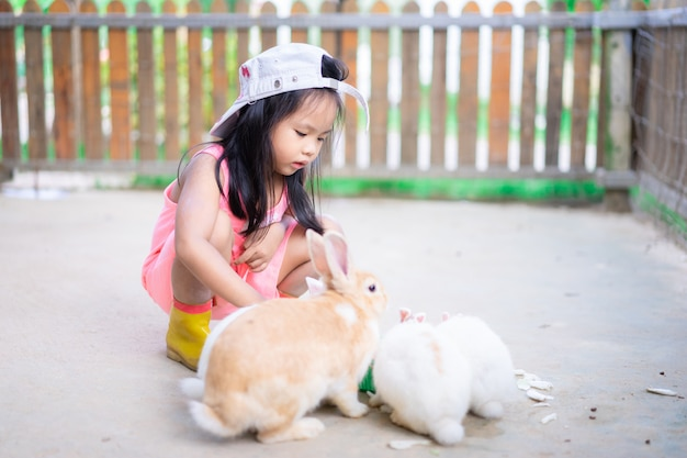 franconakad-indian-artist-young-girl-feeding-rabbits
