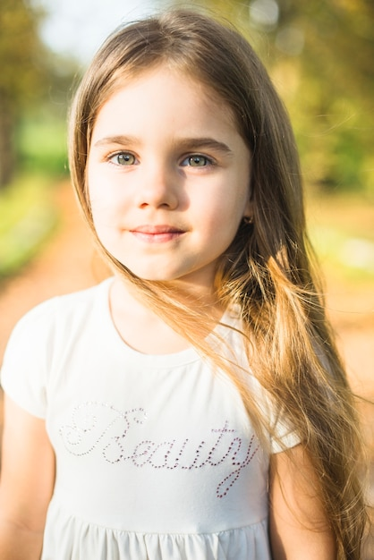 Cute Little Girl With Long Hair In White Dress Photo Free Download