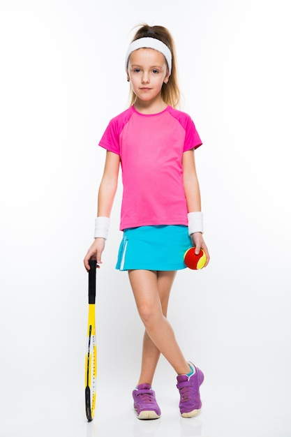 Cute little girl with tennis racket and ball on white background Premium Photo