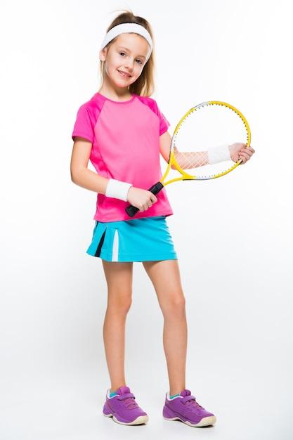Cute little girl with tennis racket in her hands Premium Photo