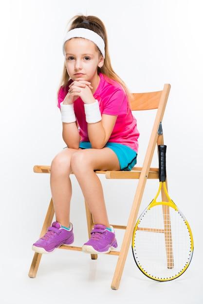 Cute little girl with tennis racket Premium Photo