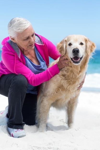 Cute mature woman petting her dog Premium Photo