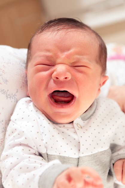 Cute new born baby crying loudly with facial gesture Premium Photo
