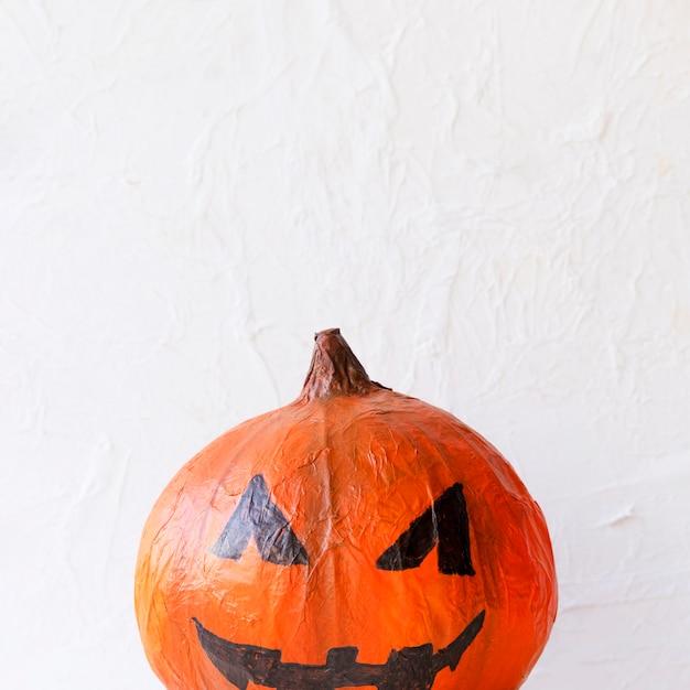Cute paper jack-o-lantern for halloween celebration Free Photo
