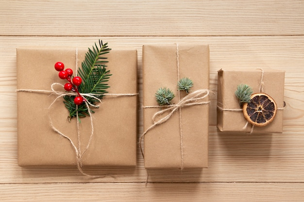Cute presents on wooden background Free Photo