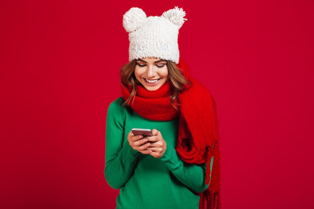 Cute pretty young woman wearing hat and scarf. Free Photo