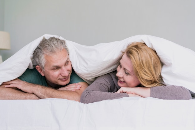 Cute senior man and woman looking at each other Free Photo
