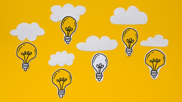 Cute silver and golden light bulbs with clouds Free Photo
