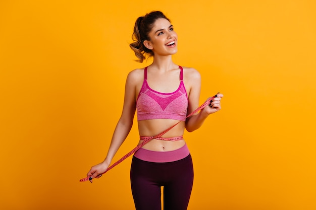 Cute slim woman expressing positive emotions after diet Free Photo
