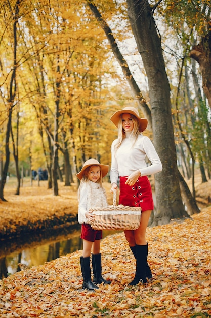 Cute and stylish family in a autumn park Free Photo