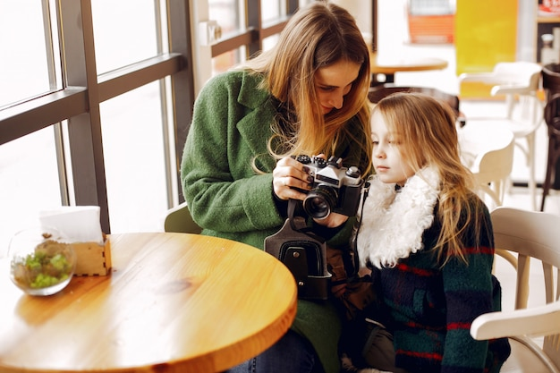 Cute and stylish family in a cafe Free Photo