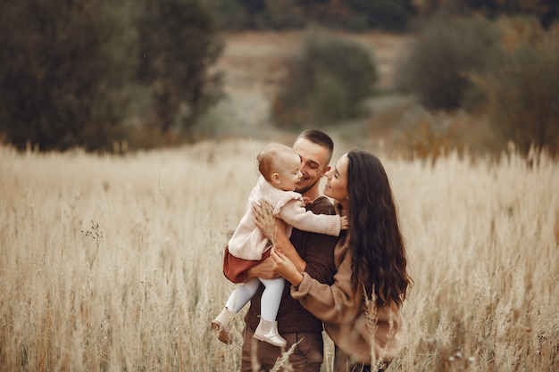 Cute and stylish family playing in a field Free Photo