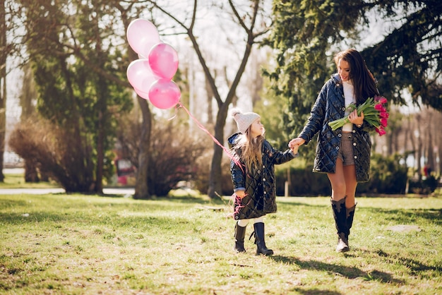 Cute and stylish family in a spring park Free Photo