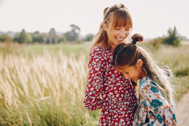 Cute and stylish family in a summer field Free Photo