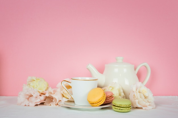 Cute tea cup with macaroons Free Photo